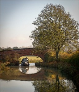 Canalboat passing under bridge on Napton Canal